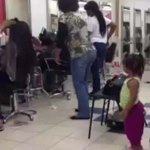 African Woman Dancing In A Hair Salon